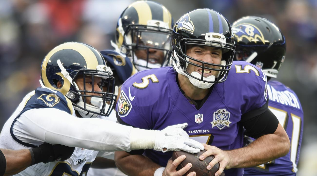 FILE - In this Nov. 22, 2015, file photo, Baltimore Ravens quarterback Joe Flacco (5) is sacked by St. Louis Rams defensive tackle Aaron Donald (99) during the first half of an NFL football game in Baltimore. Arizona Cardinals quarterback Carson Palmer sa