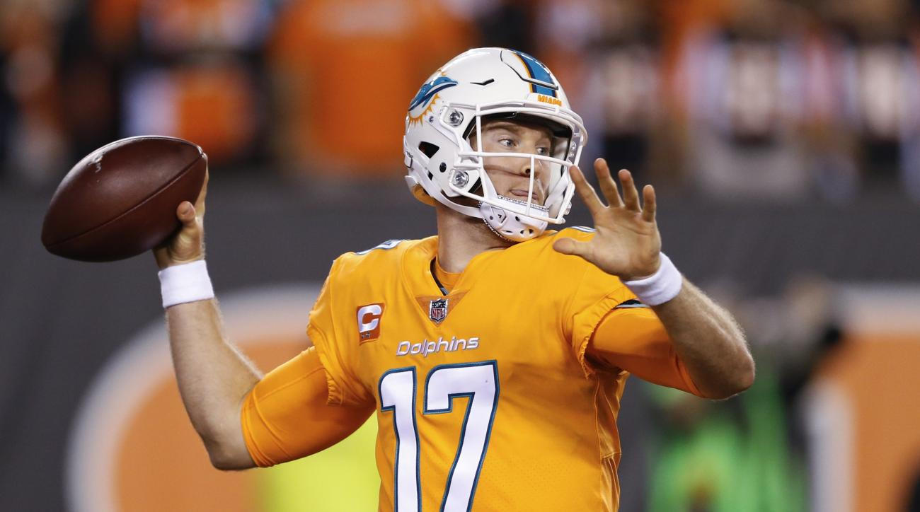 Miami Dolphins quarterback Ryan Tannehill looks to pass during the first half of an NFL football game against the Cincinnati Bengals, Thursday, Sept. 29, 2016, in Cincinnati. (AP Photo/Gary Landers)