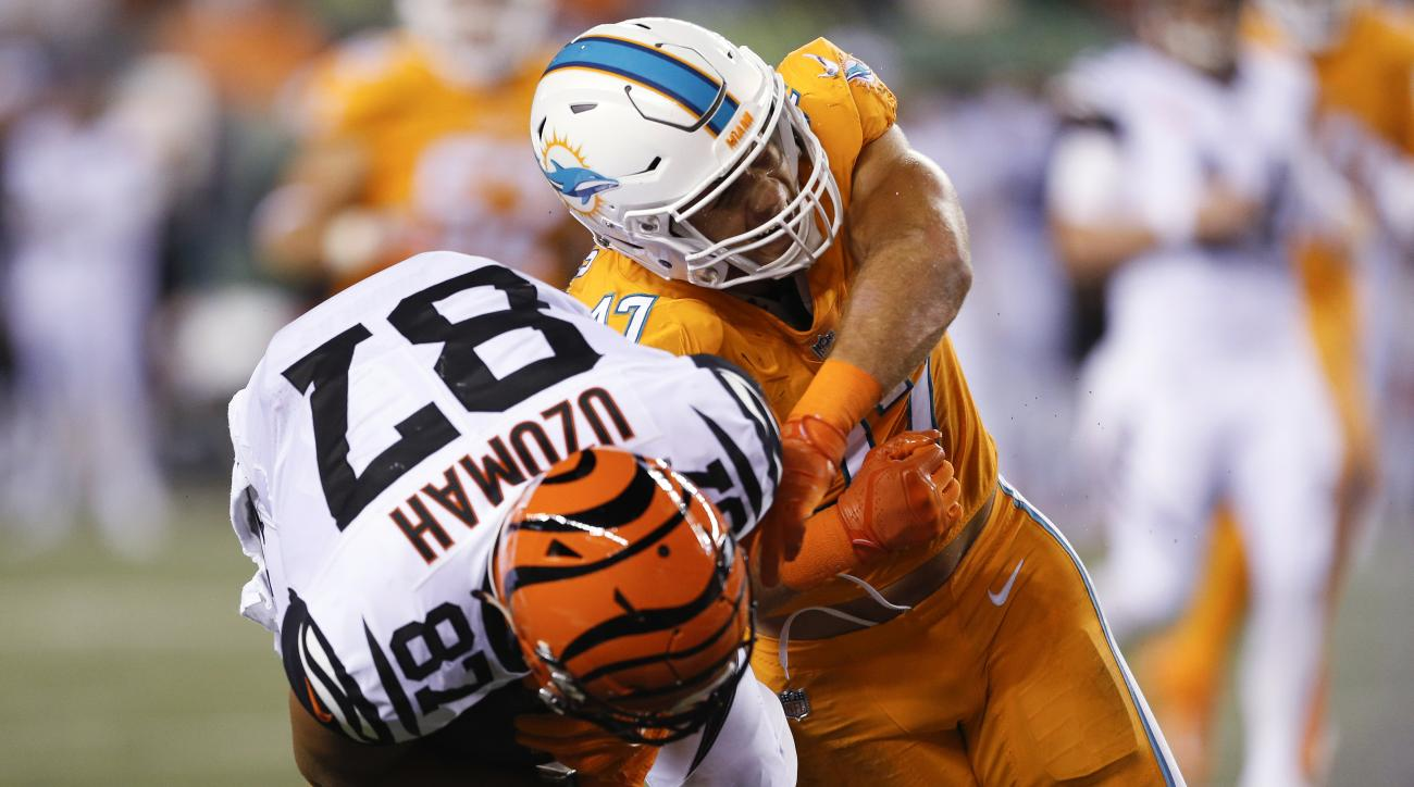 Miami Dolphins linebacker Kiko Alonso (47) tackles Cincinnati Bengals tight end C.J. Uzomah (87) during the first half of an NFL football game Thursday, Sept. 29, 2016, in Cincinnati. (AP Photo/Gary Landers)