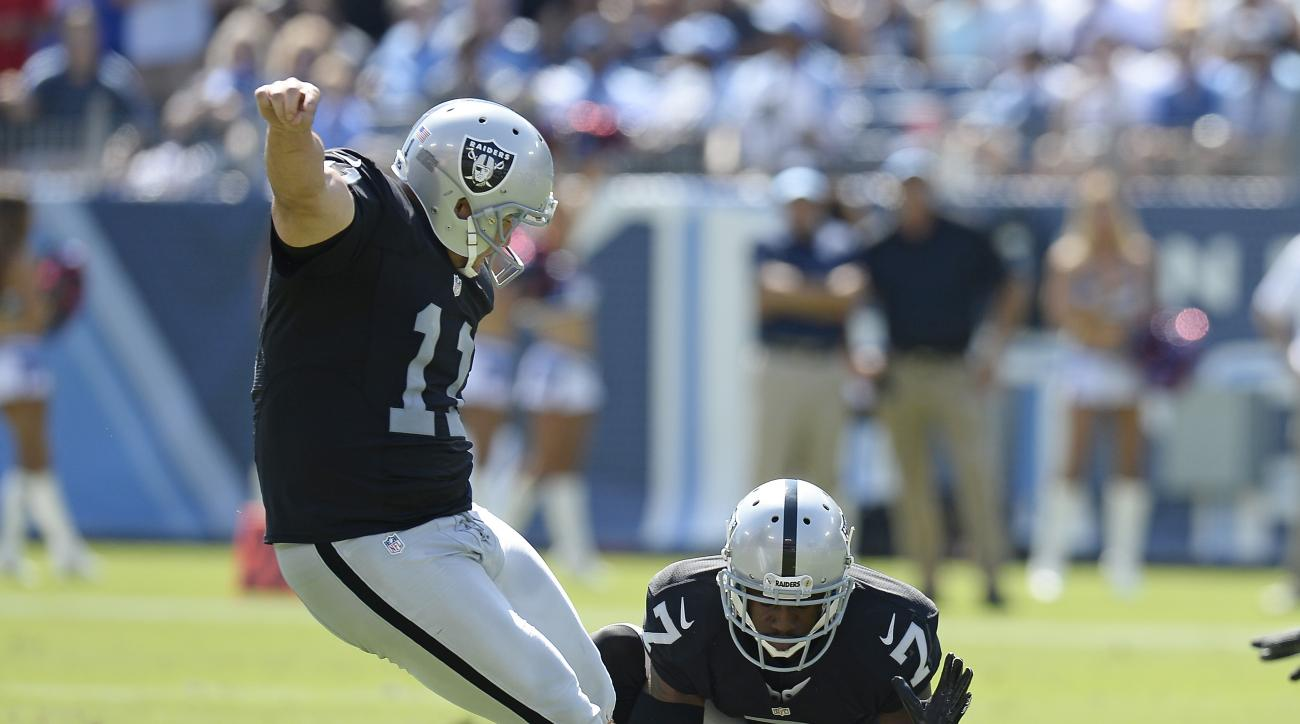 FILE - In this Sept. 25, 2016, file photo, Oakland Raiders kicker Sebastian Janikowski (11) boots a 52-yard field goal against the Tennessee Titans as Marquette King (7) holds in the first half of an NFL football game in Nashville, Tenn. Janikowski set an