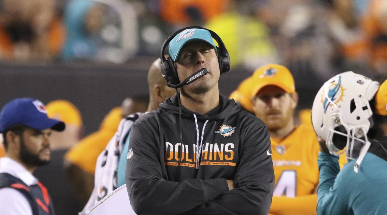 Miami Dolphins coach Adam Gase walks on the sideline during the second half of the team's NFL football game against the Cincinnati Bengals, Thursday, Sept. 29, 2016, in Cincinnati. (AP Photo/Gary Landers)