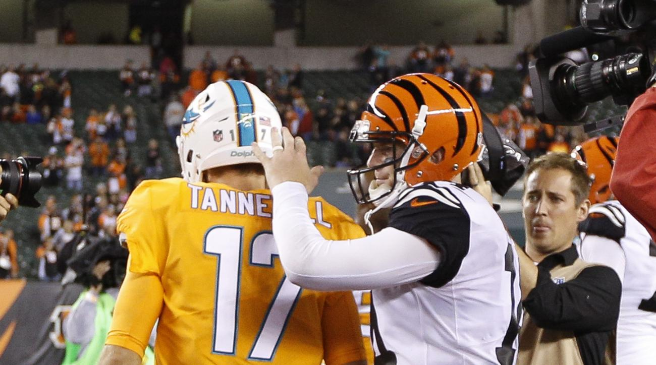 Cincinnati Bengals quarterback Andy Dalton, right, meets with Miami Dolphins quarterback Ryan Tannehill (17) after an NFL football game, Thursday, Sept. 29, 2016, in Cincinnati. The Bengals won 22-7. (AP Photo/Frank Victores)