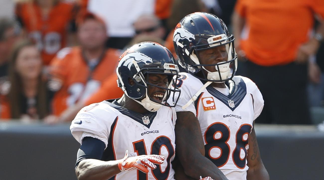 FILE - In this Sunday, Sept. 25, 2016, file photo, Denver Broncos wide receiver Demaryius Thomas (88) celebrates his touchdown with wide receiver Emmanuel Sanders (10) during the second half of an NFL football game against the Cincinnati Bengals in Cincin