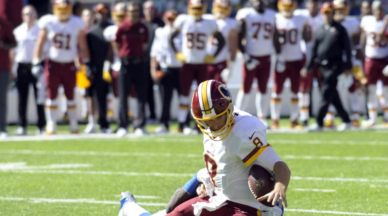 FILE - In this Sunday, Sept. 25, 2016, file photo, Washington Redskins quarterback Kirk Cousins (8) fumbles the ball as he is sacked by New York Giants' Jason Pierre-Paul (90) during the second quarter of an NFL football game in East Rutherford, N.J. Pier