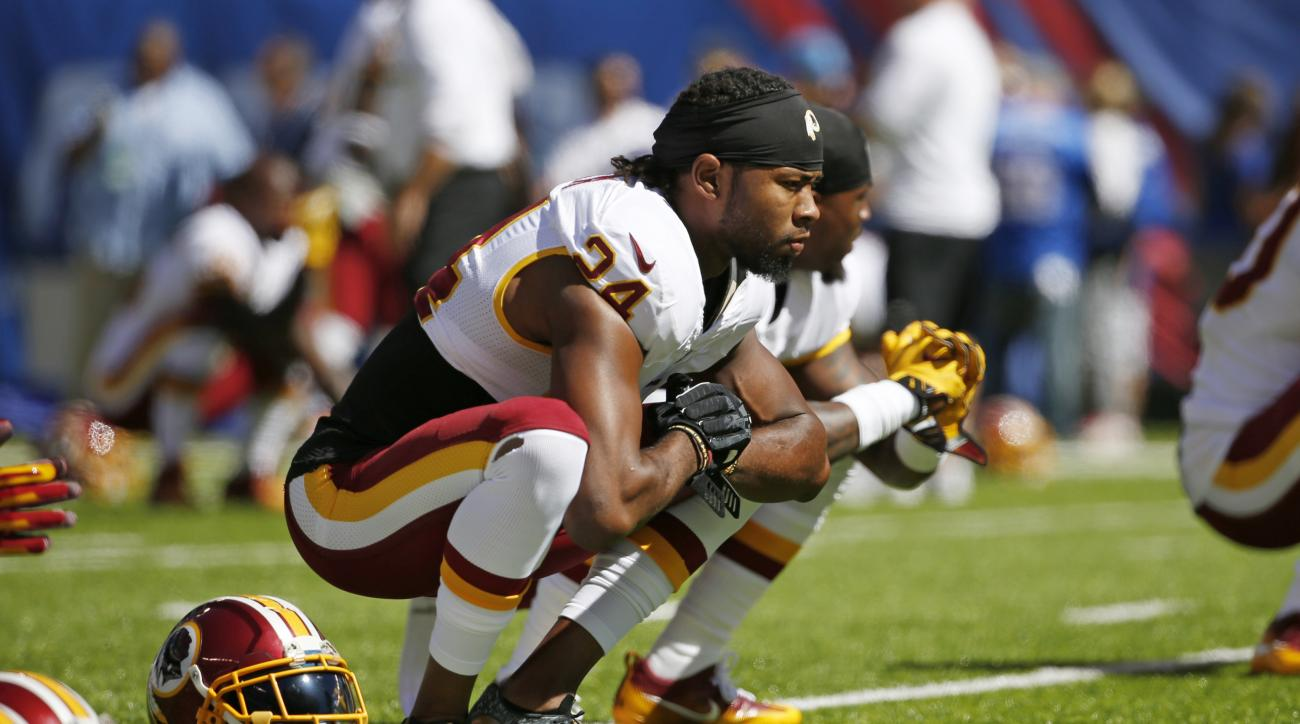 FILE - In this Sunday, Sept. 25, 2016, file photo, Washington Redskins cornerback Josh Norman  stretches an NFL football game against the New York Giants in East Rutherford, N.J.  Norman was fined $48,620 by the NFL on Friday, Sept. 30, 2016, for his unne