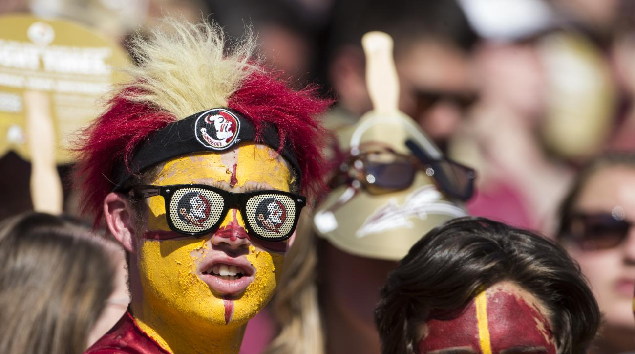 A Florida State fan watches the first half of an NCAA college football game against North Carolina in Tallahassee, Fla., Saturday, Oct. 1, 2016. North Carolina defeated Florida State 37-35.  (AP Photo/Mark Wallheiser)