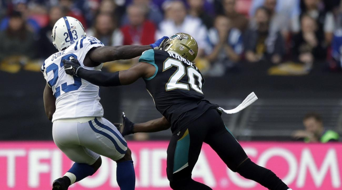 Indianapolis Colts running back Frank Gore (23) battles for the ball with Jacksonville Jaguars cornerback Jalen Ramsey (20) during an NFL football game at Wembley stadium in London, Sunday Oct. 2, 2016. (AP Photo/Matt Dunham)