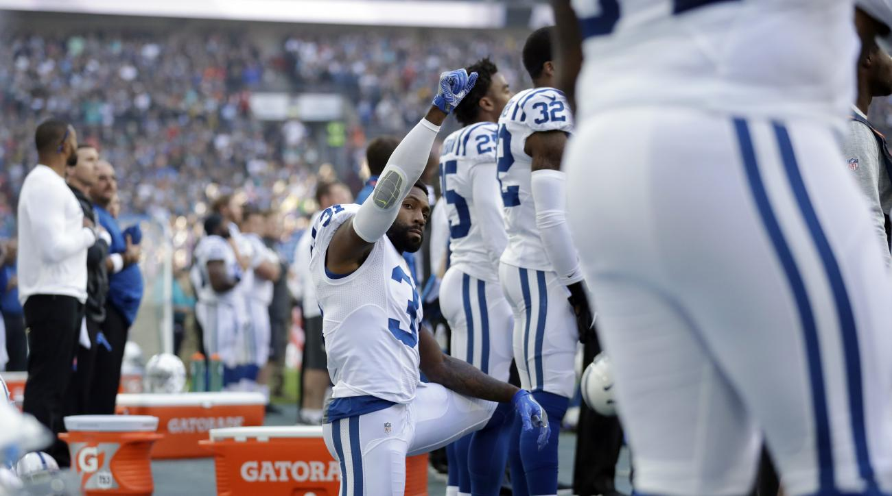 Indianapolis Colts cornerback Antonio Cromartie (31) kneels down during the national anthem before an NFL football game between the Indianapolis Colts and the Jacksonville Jaguars at Wembley stadium in London, Sunday Oct. 2, 2016. (AP Photo/Matt Dunham)