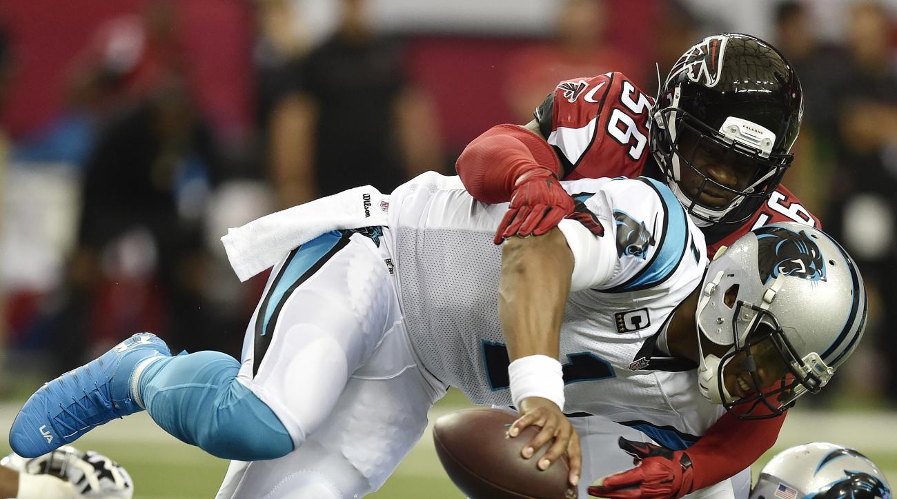 Atlanta Falcons linebacker Sean Weatherspoon (56) tackles Carolina Panthers quarterback Cam Newton (1) during the first half of an NFL football game, Sunday, Oct. 2, 2016, in Atlanta. (AP Photo/Rainier Ehrhardt)