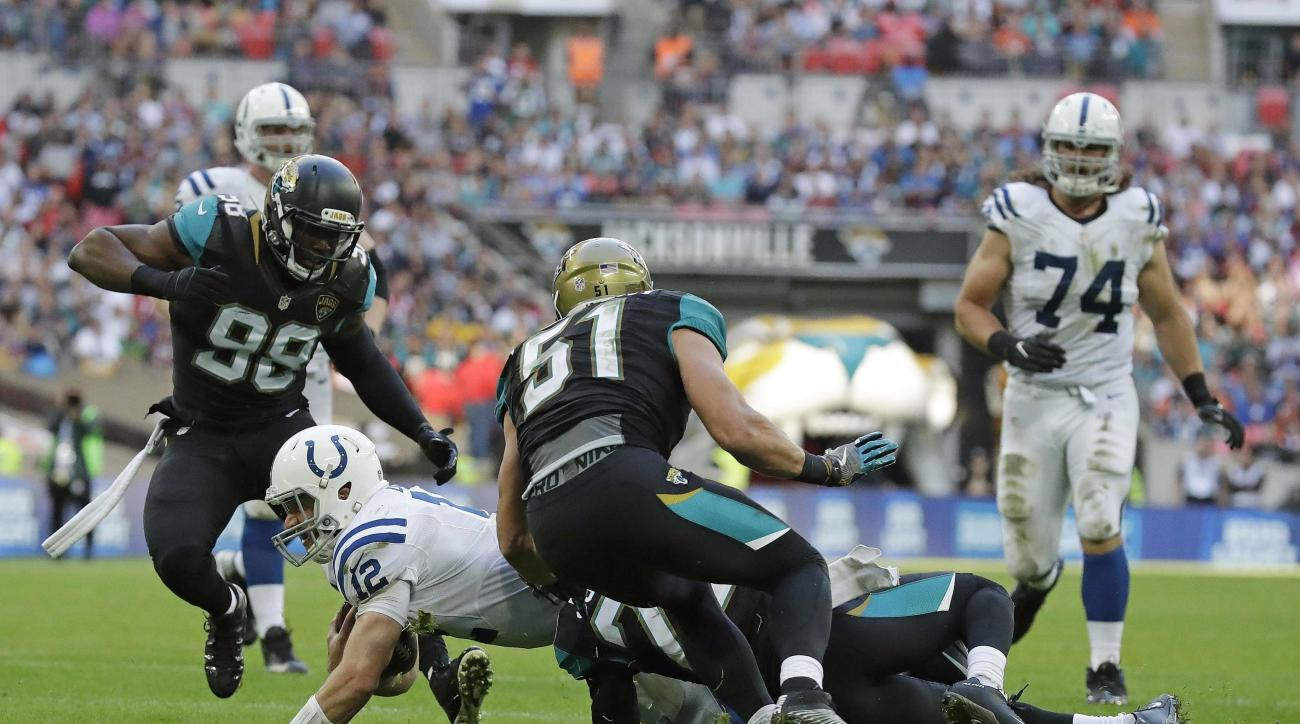Indianapolis Colts quarterback Andrew Luck (12), centre, is sacked during an NFL football game against Jacksonville Jaguars at Wembley stadium in London, Sunday Oct. 2, 2016. (AP Photo/Matt Dunham)