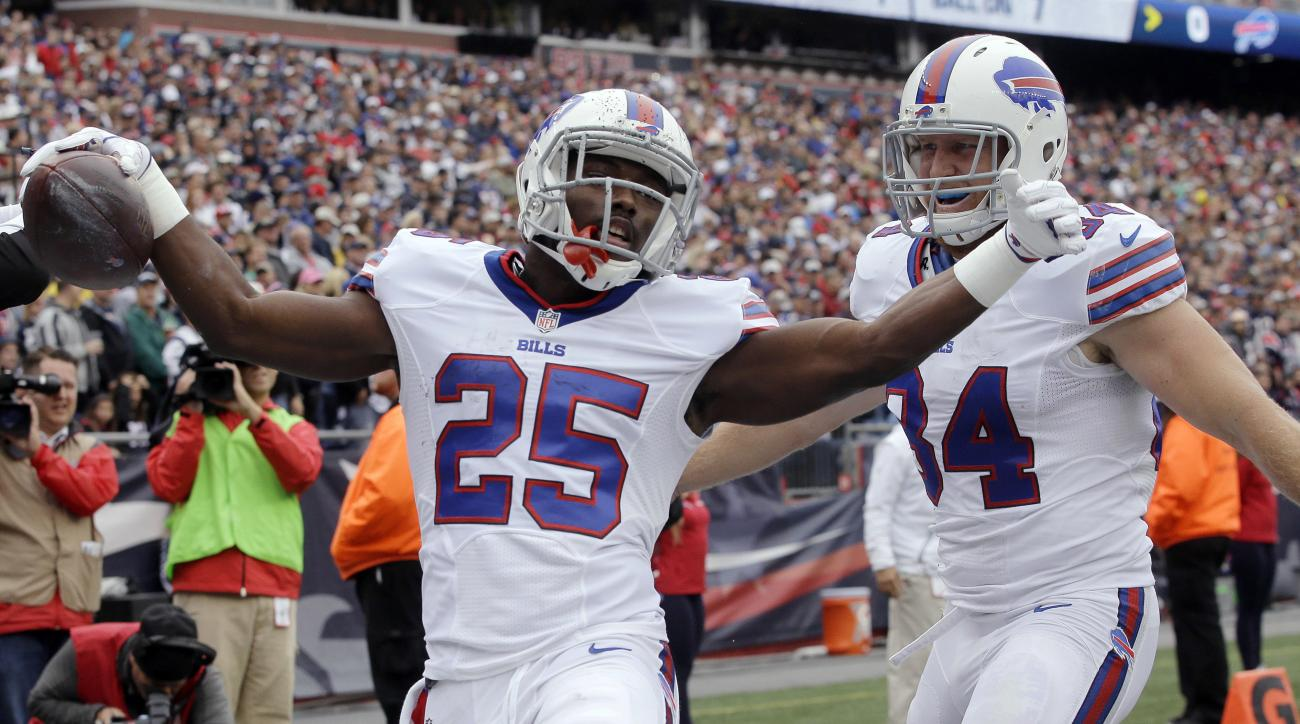 Buffalo Bills running back LeSean McCoy (25) celebrates his touchdown with tight end Nick O'Leary, right, during the first half of an NFL football game against the New England Patriots on Sunday, Oct. 2, 2016, in Foxborough, Mass. (AP Photo/Steven Senne)