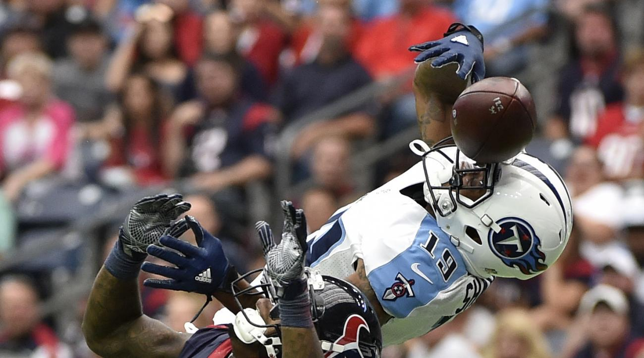 Houston Texans cornerback Kareem Jackson (25) breaks up a pass intended for Tennessee Titans wide receiver Tajae Sharpe (19) during the first half of an NFL football game, Sunday, Oct. 2, 2016, in Houston. (AP Photo/Eric Christian Smith)
