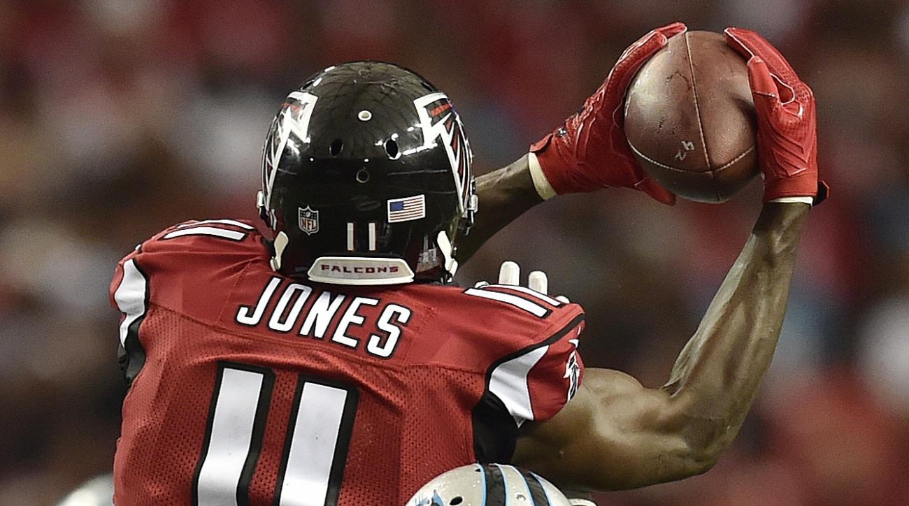 Atlanta Falcons wide receiver Julio Jones (11) makes the catch against Carolina Panthers cornerback Bene' Benwikere (25) during the second half of an NFL football game, Sunday, Oct. 2, 2016, in Atlanta. (AP Photo/Rainier Ehrhardt)