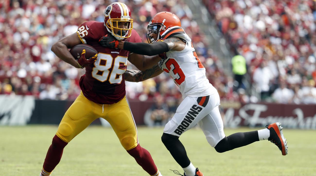 Washington Redskins tight end Jordan Reed (86) attempts to run with his reception as he is tackled by Cleveland Browns cornerback Joe Haden (23) during the first half of an NFL football game, Sunday, Oct. 2, 2016, in Landover, Md. (AP Photo/Carolyn Kaster