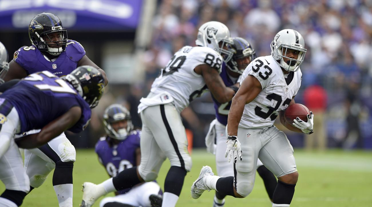 Oakland Raiders running back DeAndre Washington (33) rushes the ball in the first half of an NFL football game against the Baltimore Ravens, Sunday, Oct. 2, 2016, in Baltimore. (AP Photo/Nick Wass)