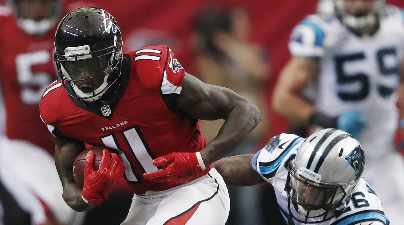 Atlanta Falcons wide receiver Julio Jones (11) runs past Carolina Panthers cornerback Daryl Worley (26) during the second half of an NFL football game, Sunday, Oct. 2, 2016, in Atlanta.  (AP Photo/John Bazemore)