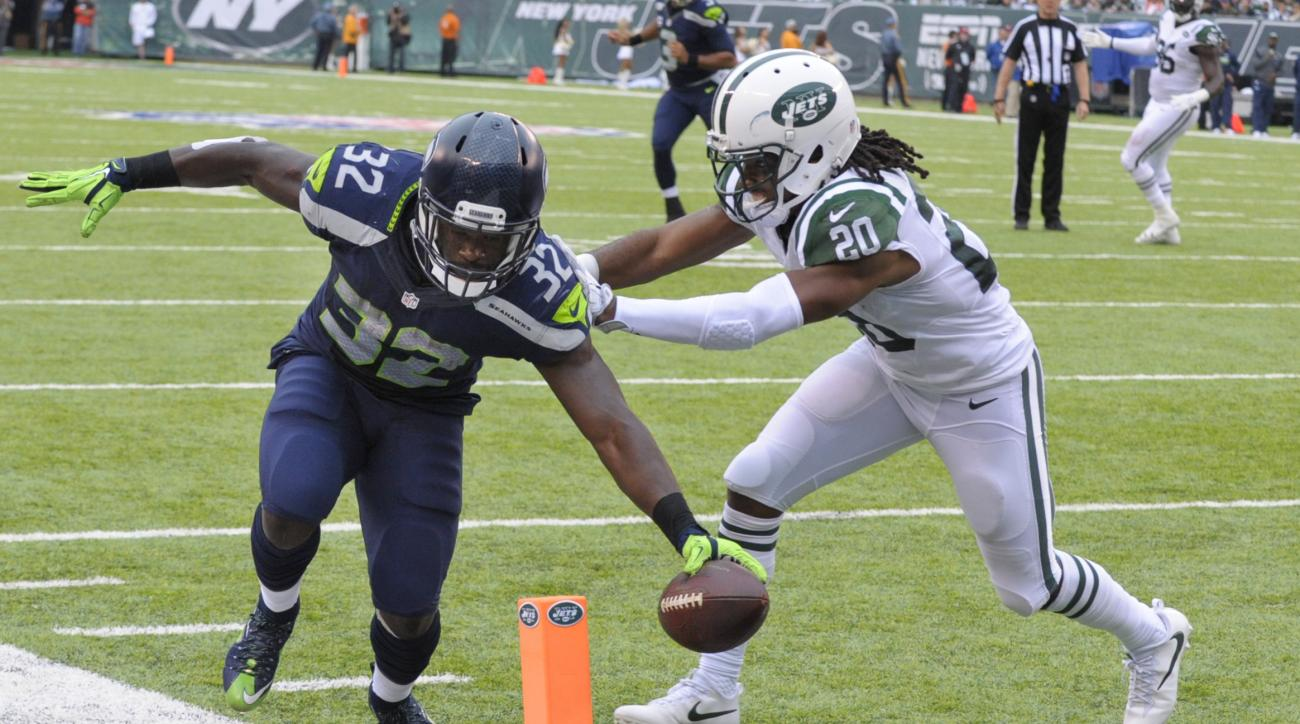 Seattle Seahawks running back Christine Michael (32) scores a touchdown as Seattle Seahawks cornerback Jeremy Lane (20) attempts to force him out of bounds during the second half of an NFL football game, Sunday, Oct. 2, 2016, in East Rutherford, N.J.  (AP