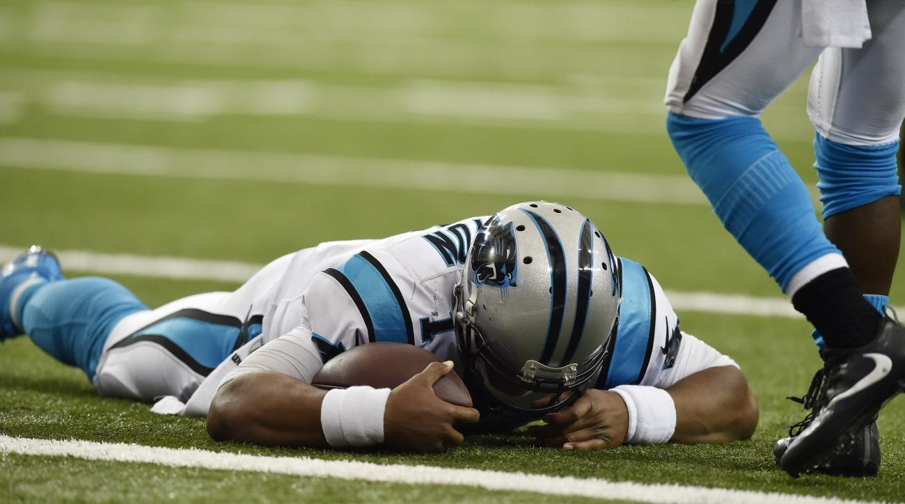 Carolina Panthers quarterback Cam Newton (1) lies on the turf after a hit during a two-point conversion against the Atlanta Falcons during the second half of an NFL football game, Sunday, Oct. 2, 2016, in Atlanta. (AP Photo/Rainier Ehrhardt)