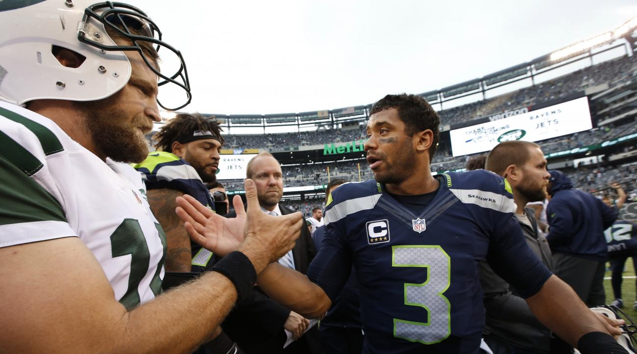 Seattle Seahawks quarterback Russell Wilson (3) greets New York Jets' Ryan Fitzpatrick (14) after an NFL football game Sunday, Oct. 2, 2016, in East Rutherford, N.J. (AP Photo/Kathy Willens)