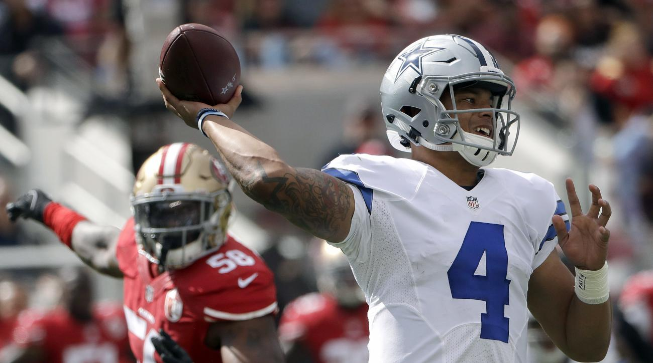 Dallas Cowboys quarterback Dak Prescott (4) passes against the San Francisco 49ers during the first half of an NFL football game in Santa Clara, Calif., Sunday, Oct. 2, 2016. (AP Photo/Marcio Jose Sanchez)
