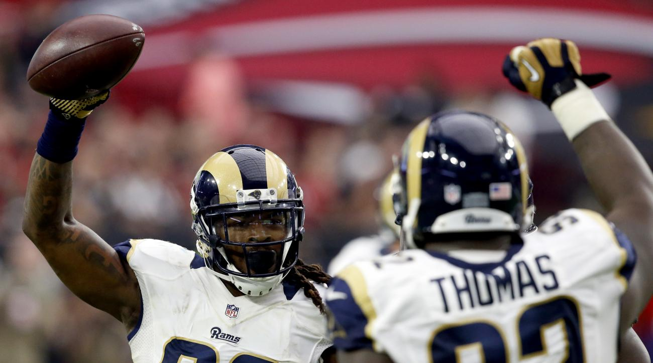 Los Angeles Rams outside linebacker Mark Barron (26) celebrates his fumble recovery against the Arizona Cardinals during the second half of an NFL football game, Sunday, Oct. 2, 2016, in Glendale, Ariz. (AP Photo/Ross D. Franklin)