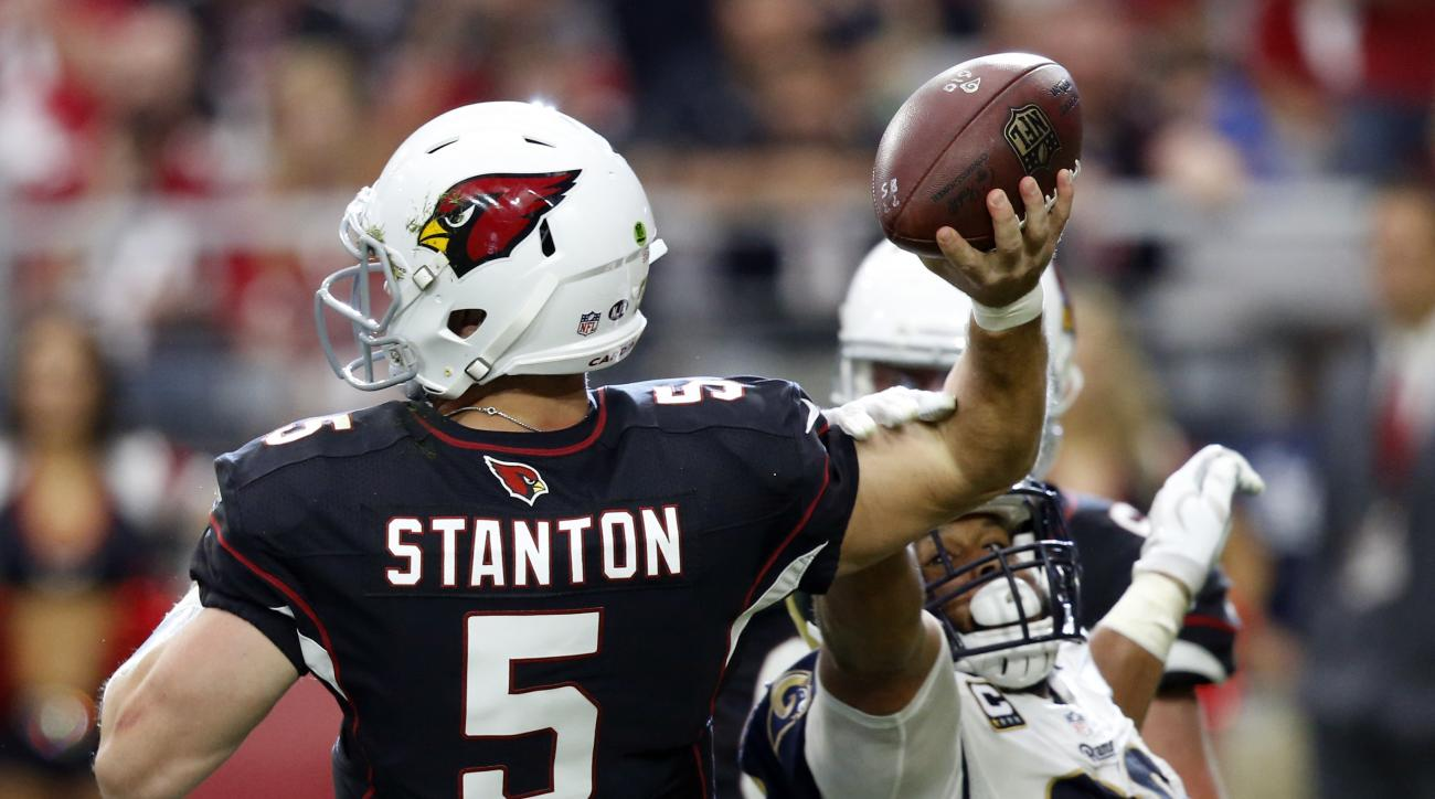 Arizona Cardinals quarterback Drew Stanton (5) is hit by Los Angeles Rams defensive tackle Aaron Donald (99) during the second half of an NFL football game, Sunday, Oct. 2, 2016, in Glendale, Ariz. (AP Photo/Ross D. Franklin)