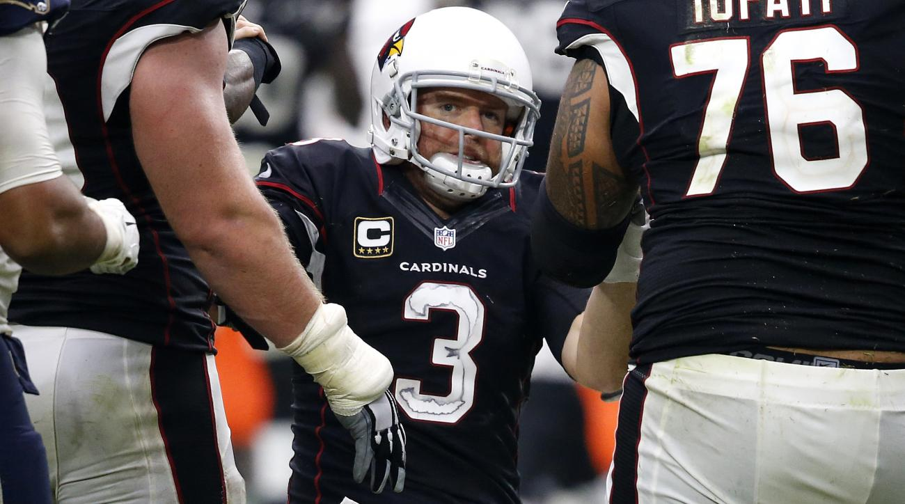 Arizona Cardinals quarterback Carson Palmer (3) is helped up after a being sacked against the Los Angeles Rams during the second half of an NFL football game, Sunday, Oct. 2, 2016, in Glendale, Ariz. Palmer left the game after the hit. (AP Photo/Ross D. F