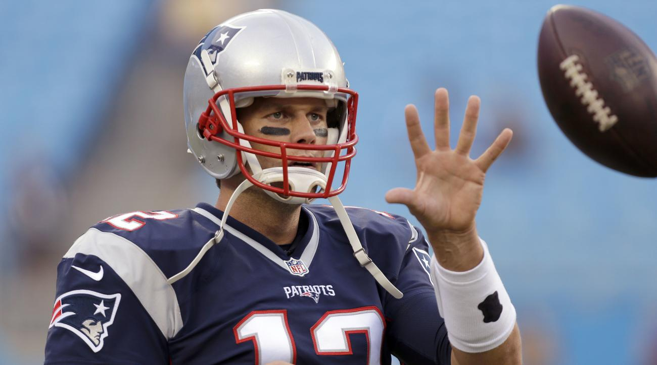 FILE  - In this Aug. 26, 2016 file photo, New England Patriots quarterback Tom Brady warms up before an NFL preseason football game against the Carolina Panthers in Charlotte, N.C. A lot has happened in the first month of the season since Tom Brady began