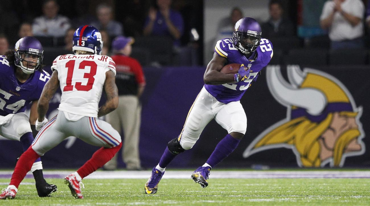 Minnesota Vikings cornerback Xavier Rhodes, right, runs from New York Giants wide receiver Odell Beckham (13) after intercepting a pass during the second half of an NFL football game Monday, Oct. 3, 2016, in Minneapolis. (AP Photo/Andy Clayton-King)