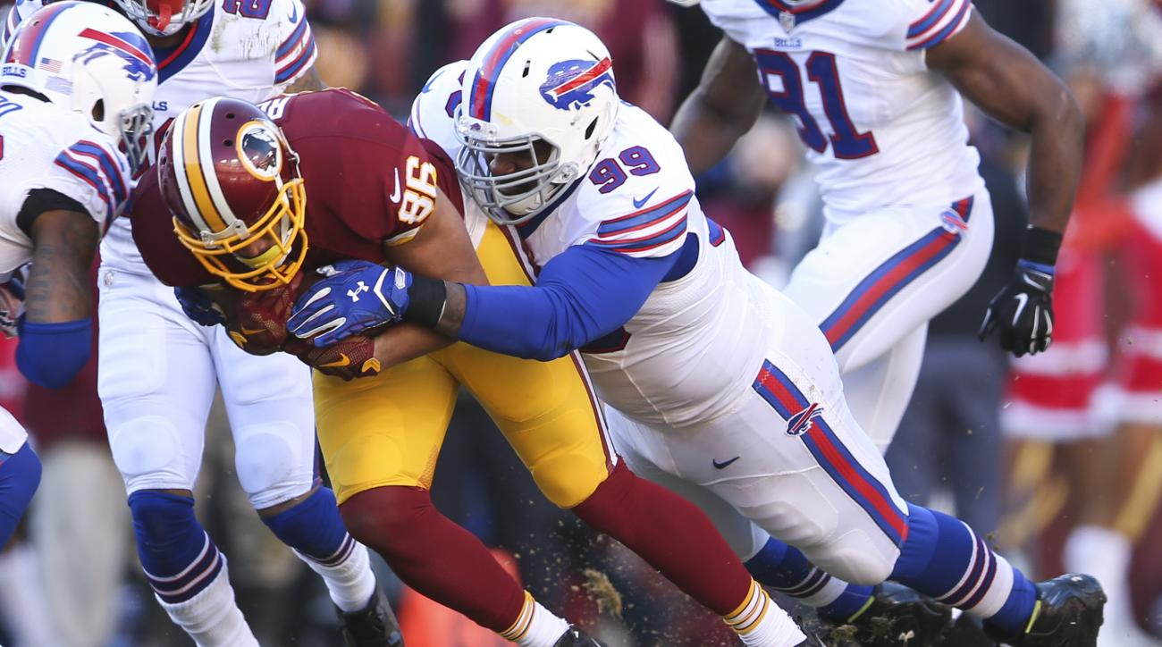 FILE - In this Dec. 20, 2015, file photo, Buffalo Bills' Marcell Dareus tackles Washington Redskins tight end Jordan Reed (86) during the first half of an NFL football game in Landover, Md.Bills star defensive tackle Marcell Dareus returns to practice on