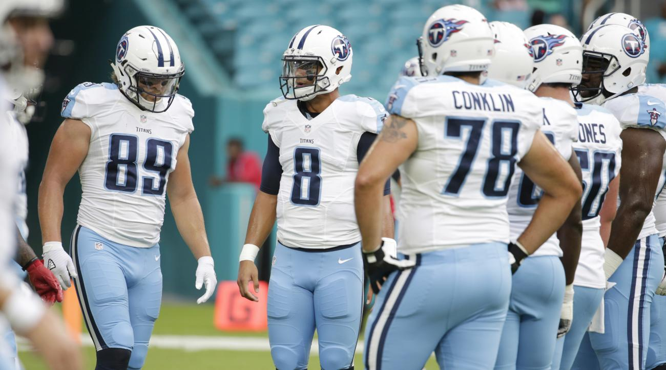 FILE - In this Sept. 1, 2016, file photo, Tennessee Titans quarterback Marcus Mariota (8) talks to the offensive line before an NFL preseason game against the Miami Dolphins, in Miami Gardens, Fla. The Titans are doing one thing better so far this season