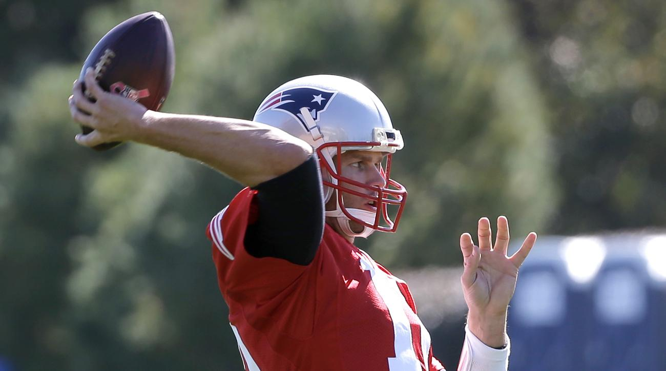 New England Patriots quarterback Tom Brady (12) winds up for a pass during an NFL football team practice Wednesday, Oct. 5, 2016, in Foxborough, Mass. (AP Photo/Steven Senne)