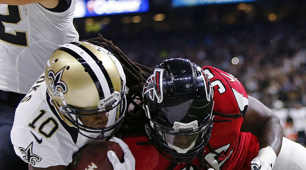 FILE - In this Sept. 26, 2016, file photo, New Orleans Saints wide receiver Brandin Cooks (10) gets near the goal line as he is tackled by Atlanta Falcons linebacker Sean Weatherspoon (56) and strong safety Kemal Ishmael (36) in the first half of an NFL f