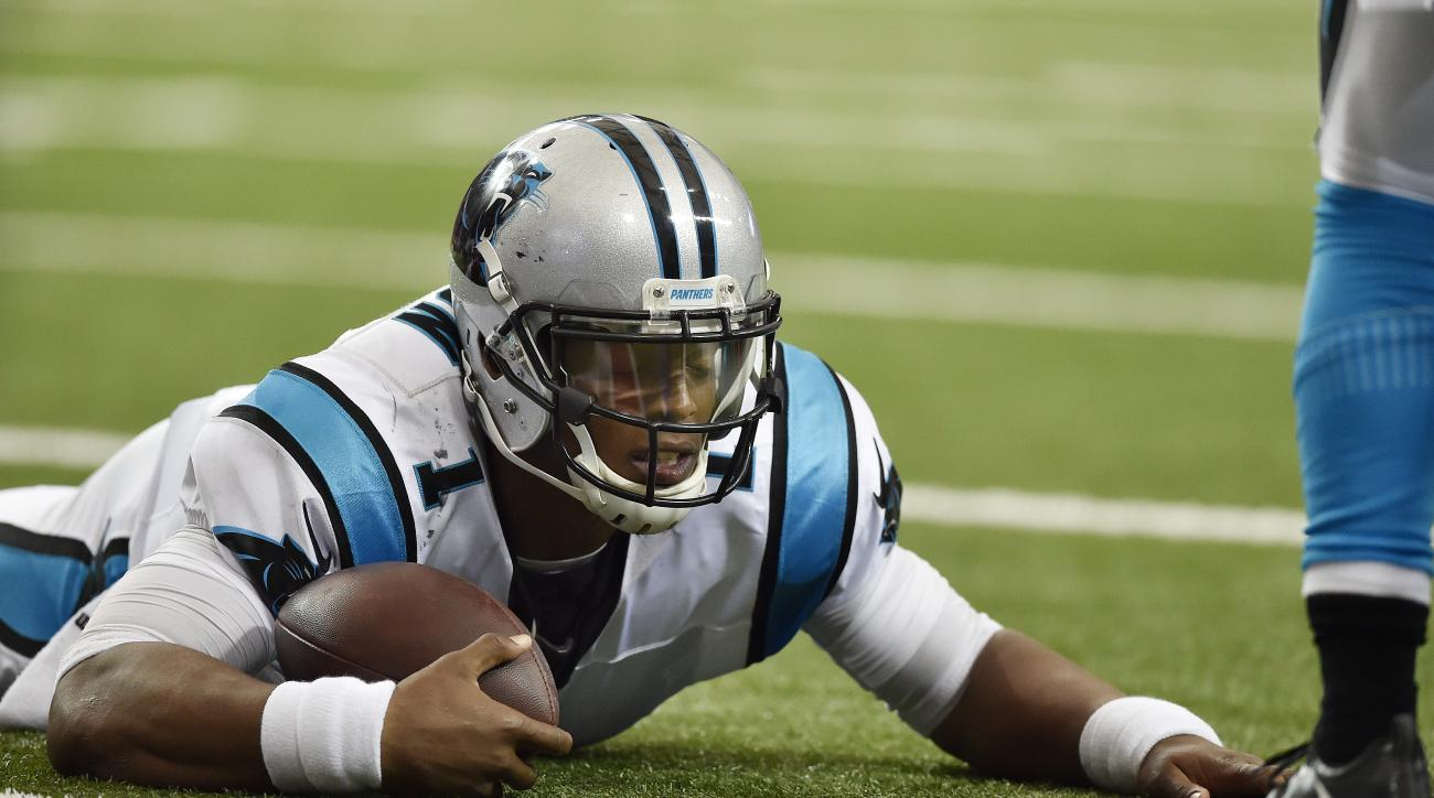 FILE - In this Oct. 2, 2016, file photo, Carolina Panthers quarterback Cam Newton (1) lies on the turf after being hit against the Atlanta Falcons during the second half of an NFL football game in Atlanta. Newton was not at the start of practice for the s