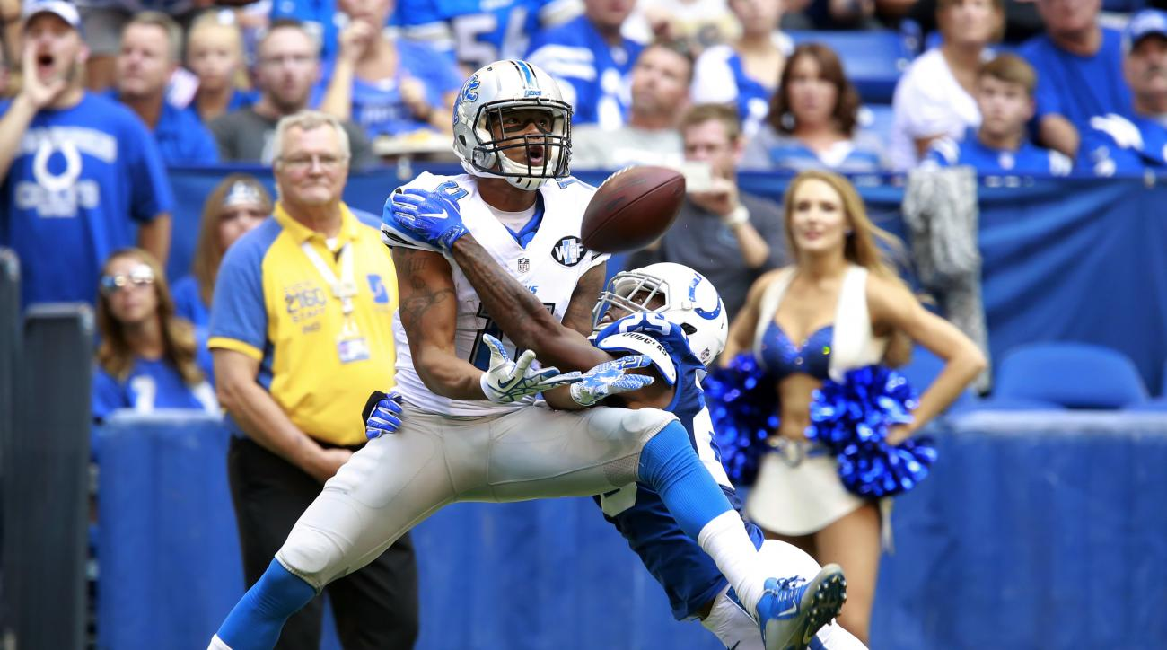 FILE - In this Sept. 11, 2016, file photo, Detroit Lions wide receiver Marvin Jones (11) makes a catch under pressure from Indianapolis Colts defensive back Patrick Robinson (25) during the first half of an NFL football game in Indianapolis. The Lions sig