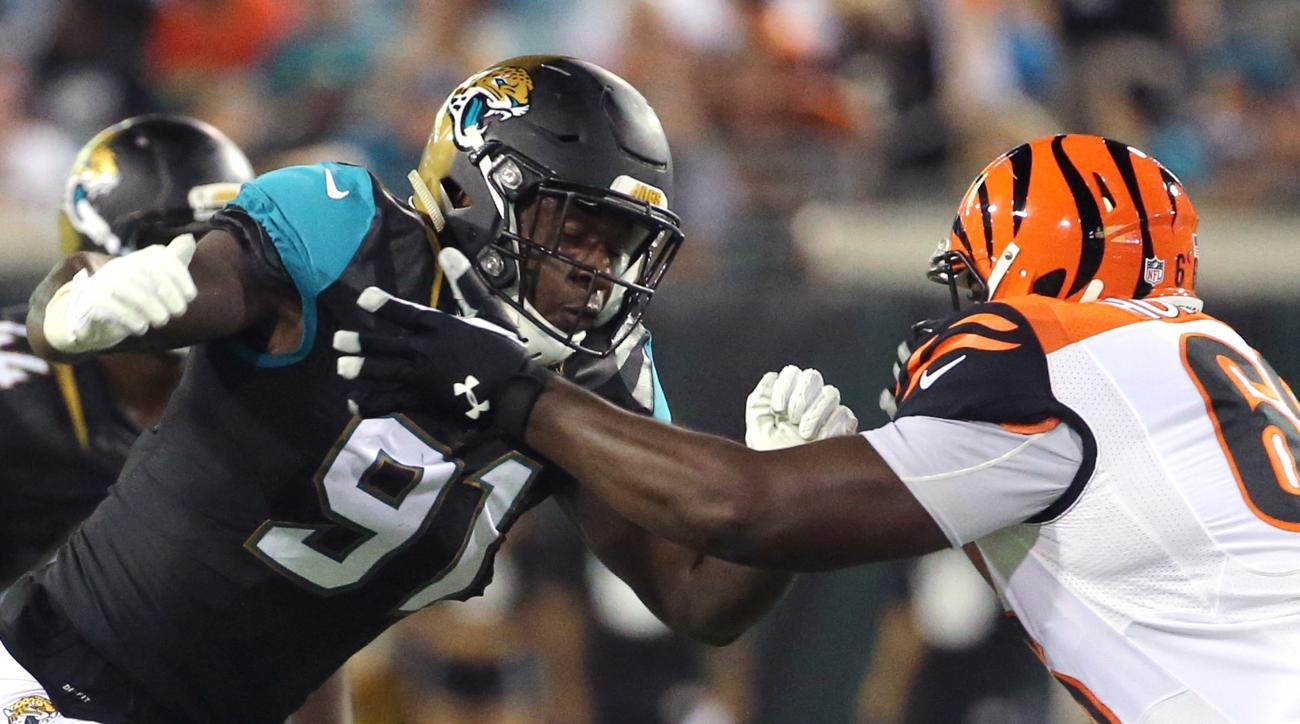 FILE - In this Aug. 28, 2016, file photo, Jacksonville Jaguars defensive end Yannick Ngakoue (91) goes head to head with Cincinnati Bengals guard Trey Hopkins during the first half half of an NFL preseason football game in Jacksonville, Fla. Rookie Ngakou