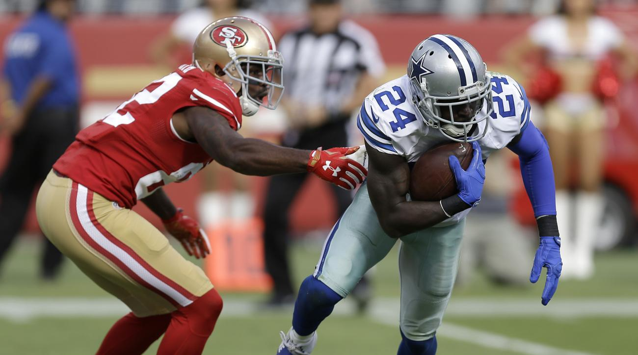 FILE - In this Oct. 2, 2016, file photo, Dallas Cowboys cornerback Morris Claiborne (24) runs with an interception in front of San Francisco 49ers wide receiver Torrey Smith (82) during the second half of an NFL football game in Santa Clara, Calif. Claibo