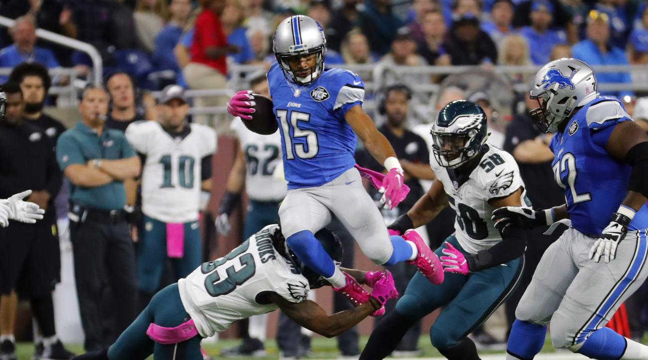 Detroit Lions wide receiver Golden Tate (15) leaps over Philadelphia Eagles cornerback Ron Brooks (33) during the first half of an NFL football game, Sunday, Oct. 9, 2016, in Detroit. (AP Photo/Rick Osentoski)
