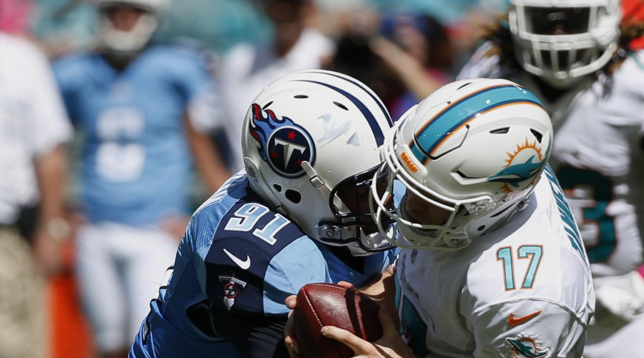 Miami Dolphins quarterback Ryan Tannehill (17) is sacked by Tennessee Titans outside linebacker Derrick Morgan (91) during the first half of an NFL football game, Sunday, Oct. 9, 2016, in Miami Gardens, Fla. (AP Photo/Wilfredo Lee)