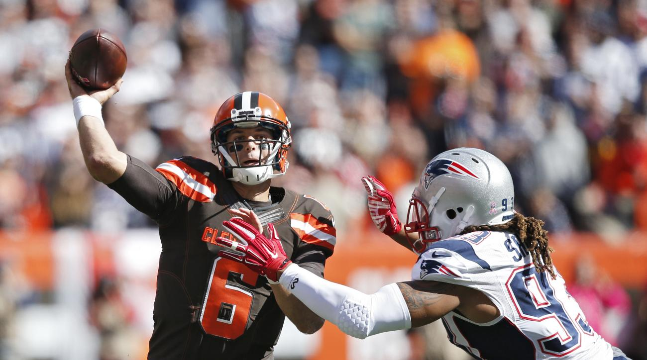 Cleveland Browns quarterback Cody Kessler (6) passes against New England Patriots defensive end Jabaal Sheard in the first half of an NFL football game Sunday, Oct. 9, 2016, in Cleveland. (AP Photo/Ron Schwane)