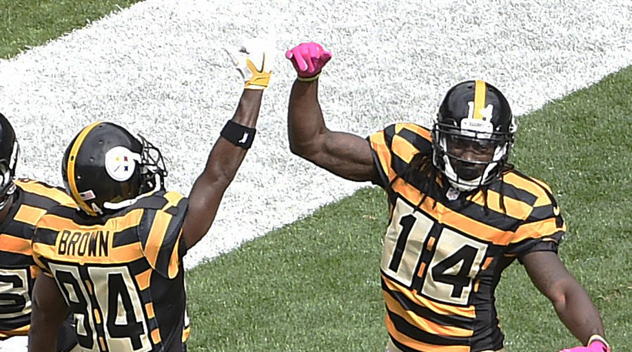 Pittsburgh Steelers wide receiver Sammie Coates (14) celebrates with Antonio Brown (84) after taking a pass from quarterback Ben Roethlisberger for a touchdown defending during the first half of an NFL football game in Pittsburgh, Sunday, Oct. 9, 2016. (A