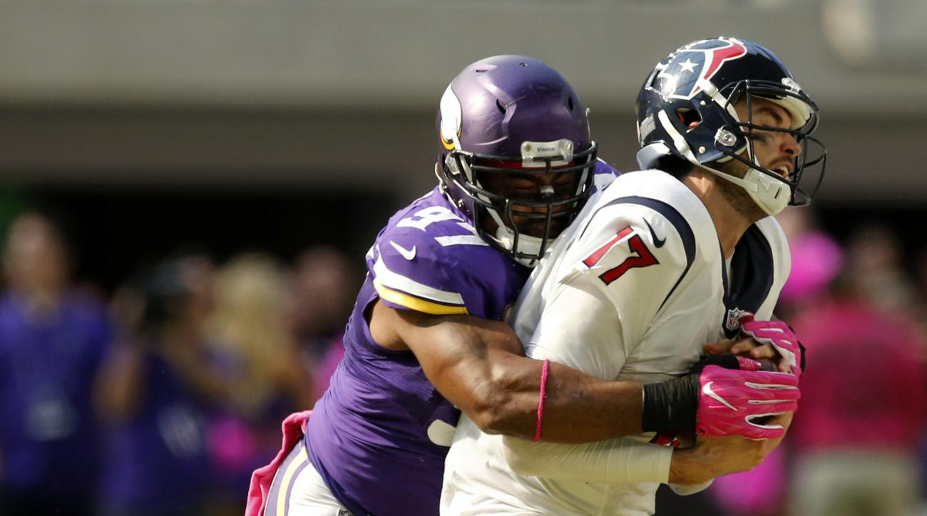 Houston Texans quarterback Brock Osweiler (17) is sacked by Minnesota Vikings defensive end Everson Griffen, left, during the first half of an NFL football game Sunday, Oct. 9, 2016, in Minneapolis. (AP Photo/Jim Mone)