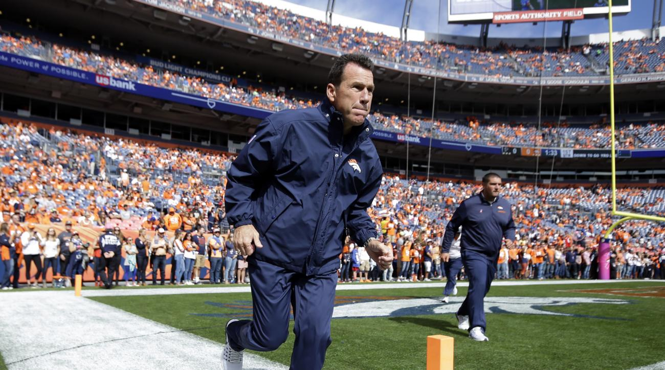 Denver Broncos head coach Gary Kubiak takes the field prior to an NFL football game against the Atlanta Falcons, Sunday, Oct. 9, 2016, in Denver. (AP Photo/Jack Dempsey)