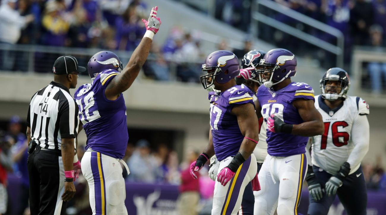 Minnesota Vikings defenders Tom Johnson, from left, Everson Griffen and Danielle Hunter celebrate after sacking Houston Texans quarterback Brock Osweiler during the second half of an NFL football game Sunday, Oct. 9, 2016, in Minneapolis. The Vikings won