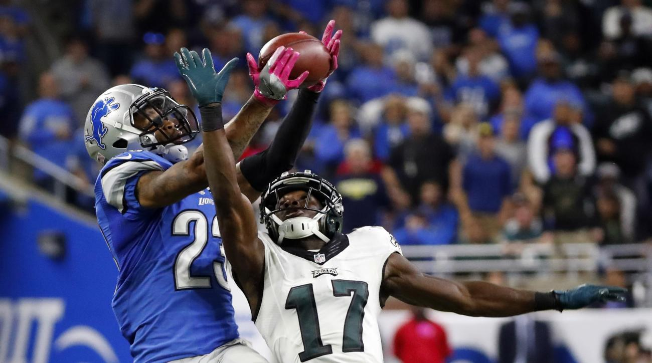 Detroit Lions cornerback Darius Slay (23) intercepts a pass intended for Philadelphia Eagles wide receiver Nelson Agholor (17) during the second half of an NFL football game, Sunday, Oct. 9, 2016, in Detroit. (AP Photo/Paul Sancya)