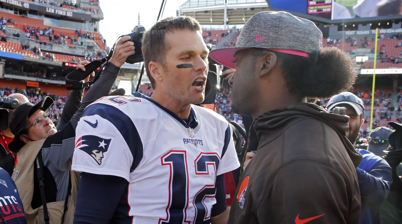 New England Patriots quarterback Tom Brady (12) meets with injured Cleveland Browns quarterback Robert Griffin III after an NFL football game Sunday, Oct. 9, 2016, in Cleveland. (AP Photo/Ron Schwane)