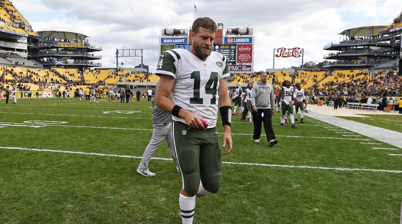 New York Jets quarterback Ryan Fitzpatrick (14) walks off the field after a loss to the Pittsburgh Steelers in an NFL football game in Pittsburgh, Sunday, Oct. 9, 2016. (AP Photo/Don Wright)