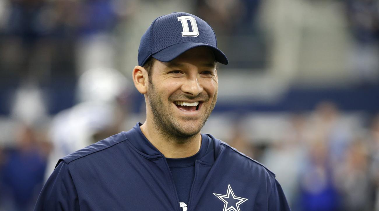 Dallas Cowboys quarterback Tony Romo smiles as he talks with teammates on the field during warm ups before an NFL football game against the Cincinnati Bengals on Sunday, Oct. 9, 2016, in Arlington, Texas. (AP Photo/Ron Jenkins)