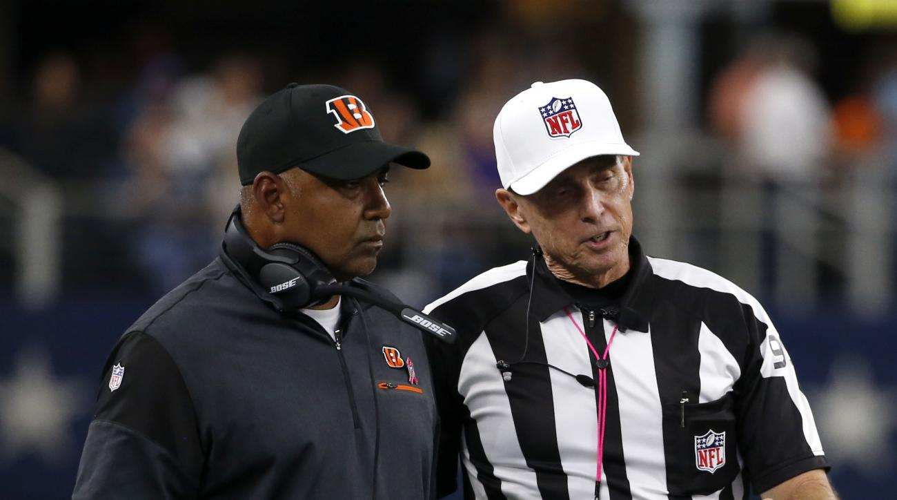 Cincinnati Bengals head coach Marvin Lewis, left, talks with referee Tony Corrente, right, in the second half of an NFL football game against the Dallas Cowboys on Sunday, Oct. 9, 2016, in Arlington, Texas. (AP Photo/Michael Ainsworth)