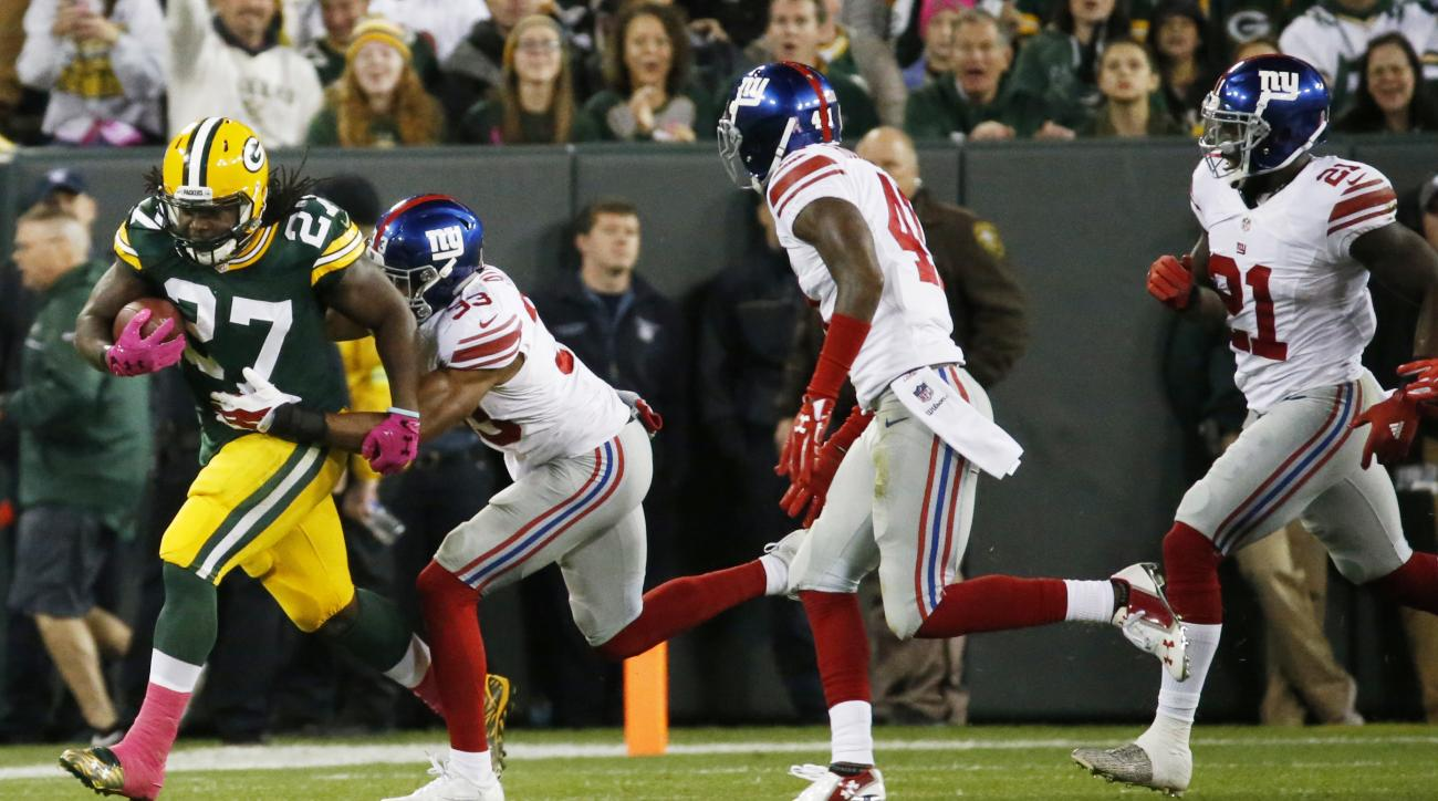 Green Bay Packers' Eddie Lacy runs during the first half of an NFL football game against the New York Giants Sunday, Oct. 9, 2016, in Green Bay, Wis. (AP Photo/Mike Roemer)